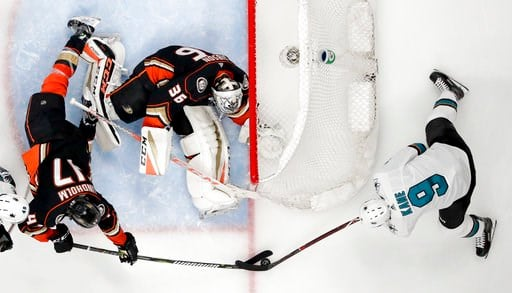 (AP Photo/Reed Saxon). Anaheim Ducks center Ryan Kesler, left, blocks a shot by San Jose Sharks left wing Evander Kane, right, as goaltender John Gibson watches during the second period of Game 1 of an NHL hockey first-round playoff series in Anaheim, ...