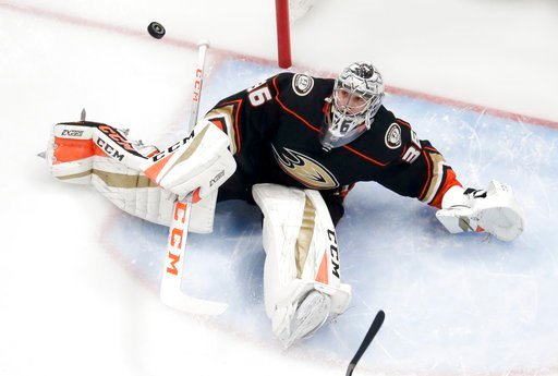 (AP Photo/Reed Saxon). Anaheim Ducks goaltender John Gibson books a shot by the San Jose Sharks during the first period of Game 1 of an NHL hockey first-round playoff series in Anaheim, Calif., Thursday, April 12, 2018.
