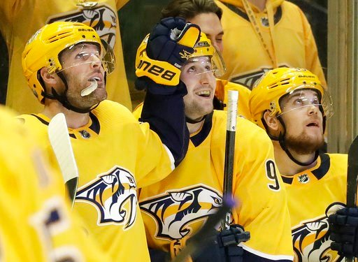 (AP Photo/Mark Humphrey). Nashville Predators left wing Filip Forsberg (9), of Sweden, watches the replay of his second goal of the game, along with Mike Fisher, left, and Viktor Arvidsson, of Sweden, right, during the third period in Game 1 of an NHL ...