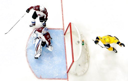 (AP Photo/Mark Humphrey). Nashville Predators left wing Filip Forsberg (9), of Sweden, celebrates after scoring his second goal of the game against Colorado Avalanche goaltender Jonathan Bernier (45), during the third period in Game 1 of an NHL hockey ...