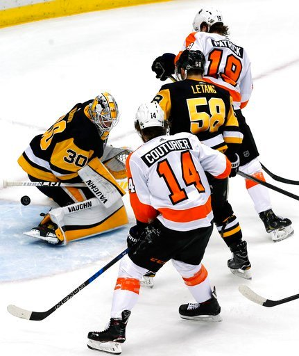 (AP Photo/Gene J. Puskar). A shot by Philadelphia Flyers' Shayne Gostisbehere gets through the pads of Pittsburgh Penguins goaltender Matt Murray (30) with Flyers' Nolan Patrick (19) providing a screen during the first period in Game 2 of an NHL first-...
