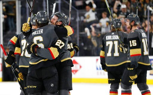 (AP Photo/John Locher). Vegas Golden Knights celebrate after defeating the Los Angeles Kings during the second overtime of Game 2 of an NHL hockey first-round playoff series, Friday, April 13, 2018, in Las Vegas.