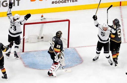 (AP Photo/John Locher). Los Angeles Kings celebrate after defenseman Paul LaDue, not seen, scored against Vegas Golden Knights goaltender Marc-Andre Fleury (29) during the second period of Game 2 of an NHL hockey first-round playoff series Friday, Apri...