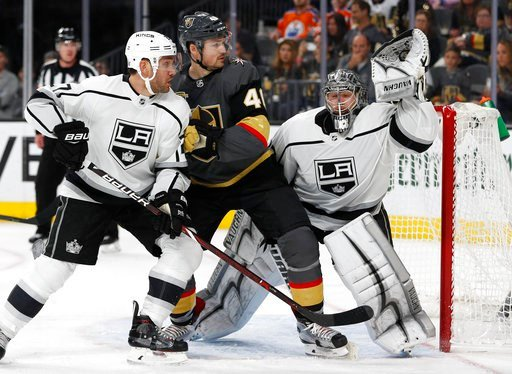 (AP Photo/John Locher). Los Angeles Kings goaltender Jonathan Quick makes a save beside Vegas Golden Knights center Ryan Carpenter, center, and Los Angeles Kings defenseman Alec Martinez, left, during the first overtime of Game 2 of an NHL hockey first...
