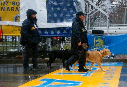 (AP Photo/Mary Schwalm). ATF K-9 units cross the start line during a security patrol before the start of the 122nd running of the Boston Marathon in Hopkinton, Mass., Monday, April 16, 2018.