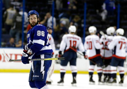(AP Photo/Chris O'Meara). Tampa Bay Lightning right wing Nikita Kucherov (86) leaves the ice as the Washington Capitals celebrate their 6-2 win during Game 2 of the NHL Eastern Conference finals hockey playoff series Sunday, May 13, 2018, in Tampa, Fla.