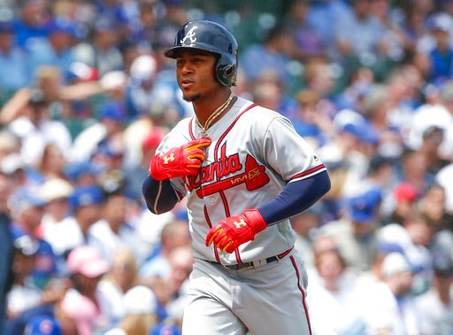 (AP Photo/Kamil Krzaczynski). Atlanta Braves' Ozzie Albies rounds the bases after hitting a solo home run off Chicago Cubs' Jose Quintana during the first inning of a baseball game, Monday, May 14, 2018, in Chicago.