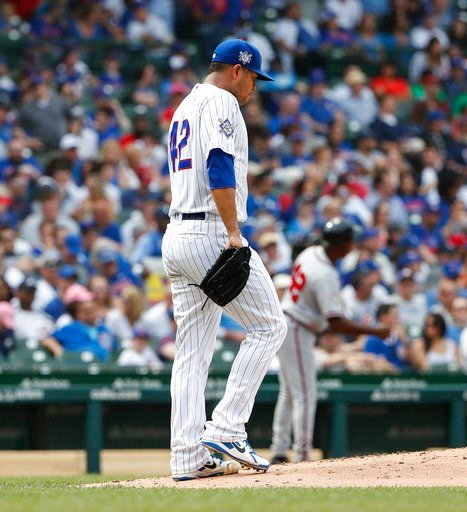 (AP Photo/Kamil Krzaczynski). Chicago Cubs' Jose Quintana reacts after giving up a run against the Atlanta Braves during the fifth inning of a baseball game, Monday, May 14, 2018, in Chicago.