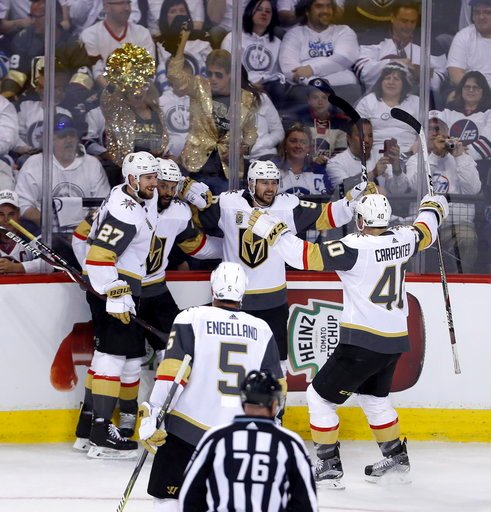 (Trevor Hagan/The Canadian Press via AP). The Las Vegas Golden Knights celebrate after Tomas Tatar (90) scored on Winnipeg Jets goaltender Connor Hellebuyck (37) during first period game 2 NHL Western Conference Finals hockey action in Winnipeg, Manito...