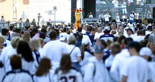 (Trevor Hagan/The Canadian Press via AP). Fans take part in the White Out Street Party, outside the Bell MTS Place, prior to game two of the Western Conference hockey Finals between the Las Vegas Golden Knights and the Winnipeg Jets, in Winnipeg, Manit...