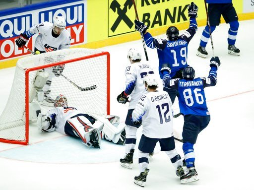 (AP Photo/Petr David Josek). Keith Kinkaid of the United States lies on ice after failing to make a save during the Ice Hockey World Championships group B match between Finland and the United States at the Jyske Bank Boxen arena in Herning, Denmark, Tu...