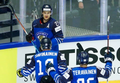 (AP Photo/Petr David Josek). Finland's Sebastian Aho, back, celebrates with teammates Veli-Matti Savinainen, center, and Teuvo Teravainen,front, after scoring his sides first goal during the Ice Hockey World Championships group B match between Finland ...