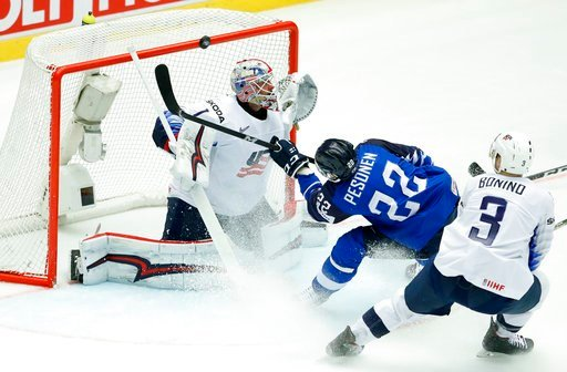 (AP Photo/Petr David Josek). Finland's Janne Pesonen, center, fails to score past Nick Bonino, right, of the United States and Keith Kinkaid, left, during the Ice Hockey World Championships group B match between Finland and the United States at the Jys...
