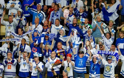 (AP Photo/Petr David Josek). Fans of Finland celebrate a goal during the Ice Hockey World Championships group B match between Finland and the United States at the Jyske Bank Boxen arena in Herning, Denmark, Tuesday, May 15, 2018.