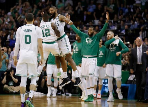 (AP Photo/Charles Krupa). Boston Celtics guard Terry Rozier (12) and forward Marcus Morris leap in celebration near the end of Game 2 of the team's NBA basketball Eastern Conference finals against the Cleveland Cavaliers, Tuesday, May 15, 2018, in Bost...