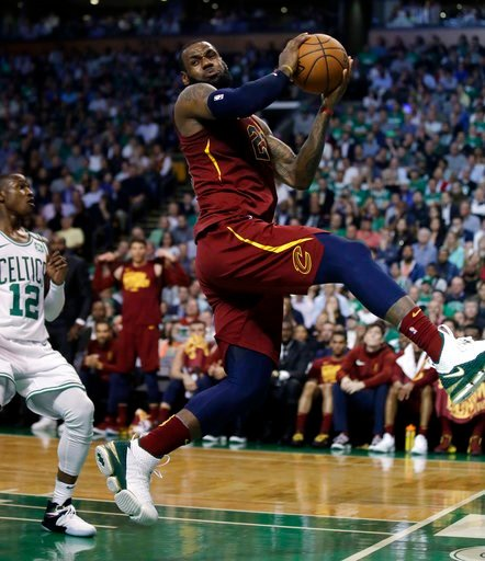 (AP Photo/Charles Krupa). Cleveland Cavaliers forward LeBron James recoils after colliding with Boston Celtics forward Jayson Tatum, out of picture, in front of Celtics guard Terry Rozier, left, during the first half in Game 2 of the NBA basketball Eas...