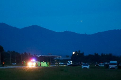 (AP Photo/Vincent Thian). An ambulance waiting for arrival of helicopter of the rescued boys from the flooded cave, in the Mae Sai district of Chiang Rai province, northern Thailand, Monday, July 9, 2018.