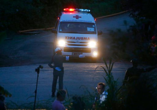 (AP Photo/Sakchai Lalit). One of two ambulances with flashing lights leaves the cave rescue area in Mae Sai, Chiang Rai province, northern Thailand, Monday, July 9, 2018. The ambulance has left the cave complex area hours after the start of the second ...