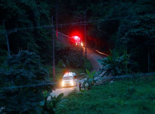 (AP Photo/Sakchai Lalit). Two ambulances with flashing lights leaves the cave rescue area in Mae Sai, Chiang Rai province, northern Thailand, Monday, July 9, 2018. The ambulance has left the cave complex area hours after the start of the second phase o...